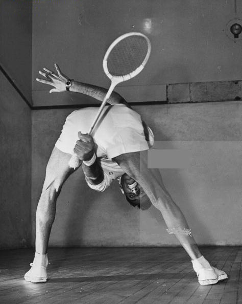 Pakistani-squash-player-Muhibullah-Khan-hitting-a-shot-through-his-legs-on-4th-February-1958.